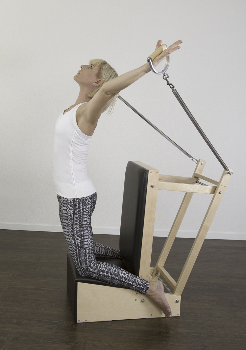 Social52.ch Fitness and Portrait Photography - Christine Huesler of Pilateswerkstatt Zug on Gratz Baby Chair